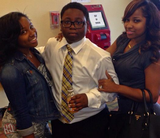 Lil Wayne's daughter Reginae Carter with her uncle Semaj and mother Antonia Wright
